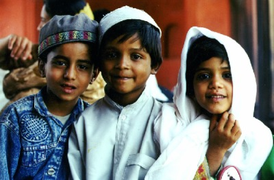 A   picture of three muslim children